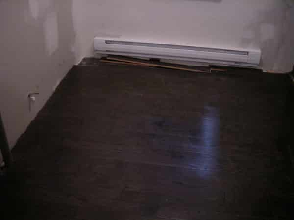 First remove the front of the baseboard heater cover from the unit.