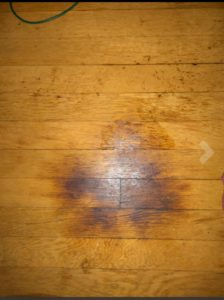 Burnt wooden floor caused by leaving space heater on overnight.